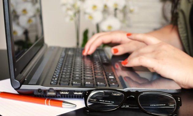 person woman desk laptop